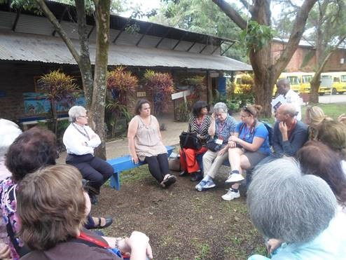 Gemma Sisia, founder of the School of St. Jude, speaking with a past delegation